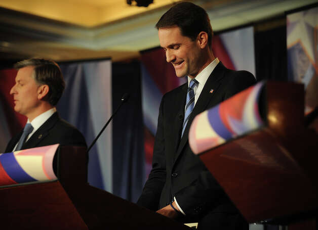 Republican challenger Steve Obsitnik, left, and U.S. Rep. Jim Himes participate in the U.S. Congressional Fourth District Debate at the Norwalk Inn & Conference Center in Norwalk on Thursday, October 18, 2012. Photo: Brian A. Pounds / Connecticut Post