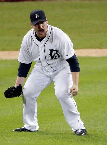 Detroit Tigers' Phil Coke celebrates after winning Game 4 of the American League championship series