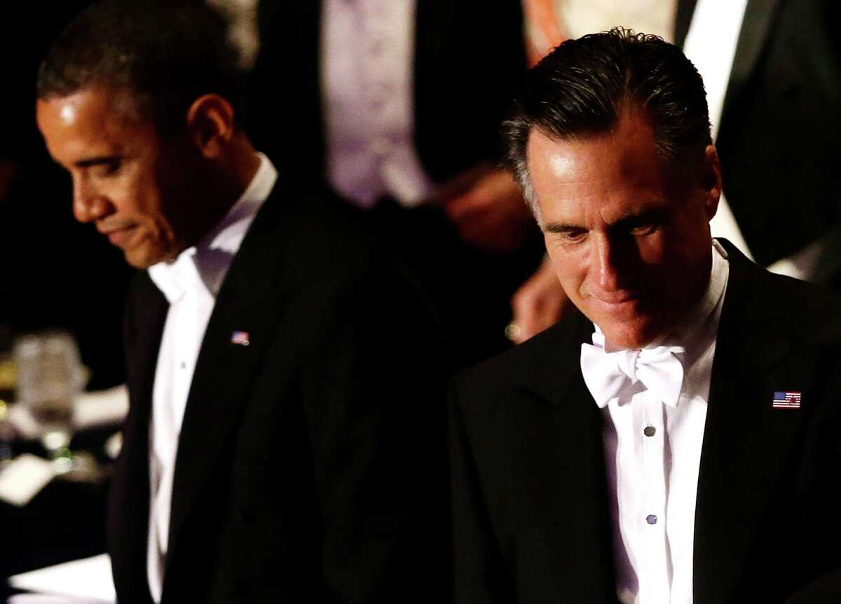 Republican presidential candidate and former Massachusetts Gov. Mitt Romney and President Barack Obama attend the 67th annual Alfred E. Smith Memorial Foundation Dinner, a charity gala organized by the Archdiocese of New York, Thursday, Oct. 18, 2012, at the Waldorf Astoria hotel in New York.