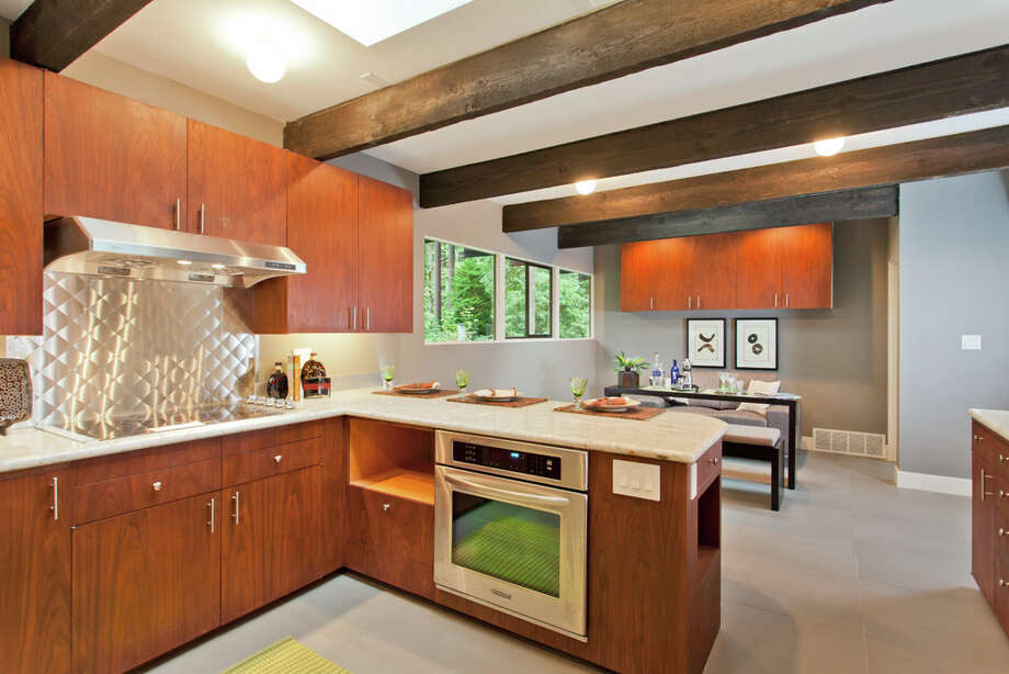 Kitchen of 13249 6th Ave. N.W.. The 3,850-square-foot house, built in 1965, has five bedrooms, 2.75 bathrooms, walls of windows, beamed ceilings, skylights, a large deck, a patio and a two-car garage on an 8,100-square-foot lot. It's listed for $899,950. Photo: COurtesy Tim Lenihan/Windermere Real Estate / (c) 2012 Malia Campbell Photography
