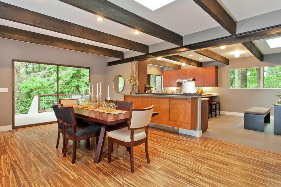 Dining room of 13249 6th Ave. N.W.. The 3,850-square-foot house, built in 1965, has five bedrooms, 2.75 bathrooms, walls of windows, beamed ceilings, skylights, a large deck, a patio and a two-car garage on an 8,100-square-foot lot. It's listed for $899,950. Photo: COurtesy Tim Lenihan/Windermere Real Estate / (c) 2012 Malia Campbell Photography