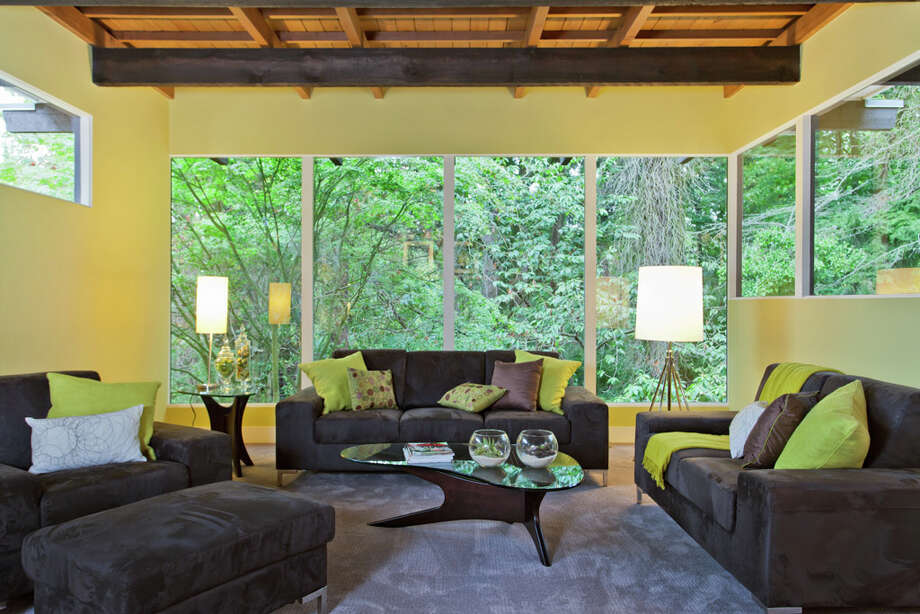 Living room of 13249 6th Ave. N.W.. The 3,850-square-foot house, built in 1965, has five bedrooms, 2.75 bathrooms, walls of windows, beamed ceilings, skylights, a large deck, a patio and a two-car garage on an 8,100-square-foot lot. It's listed for $899,950. Photo: COurtesy Tim Lenihan/Windermere Real Estate / (c) 2012 Malia Campbell Photography