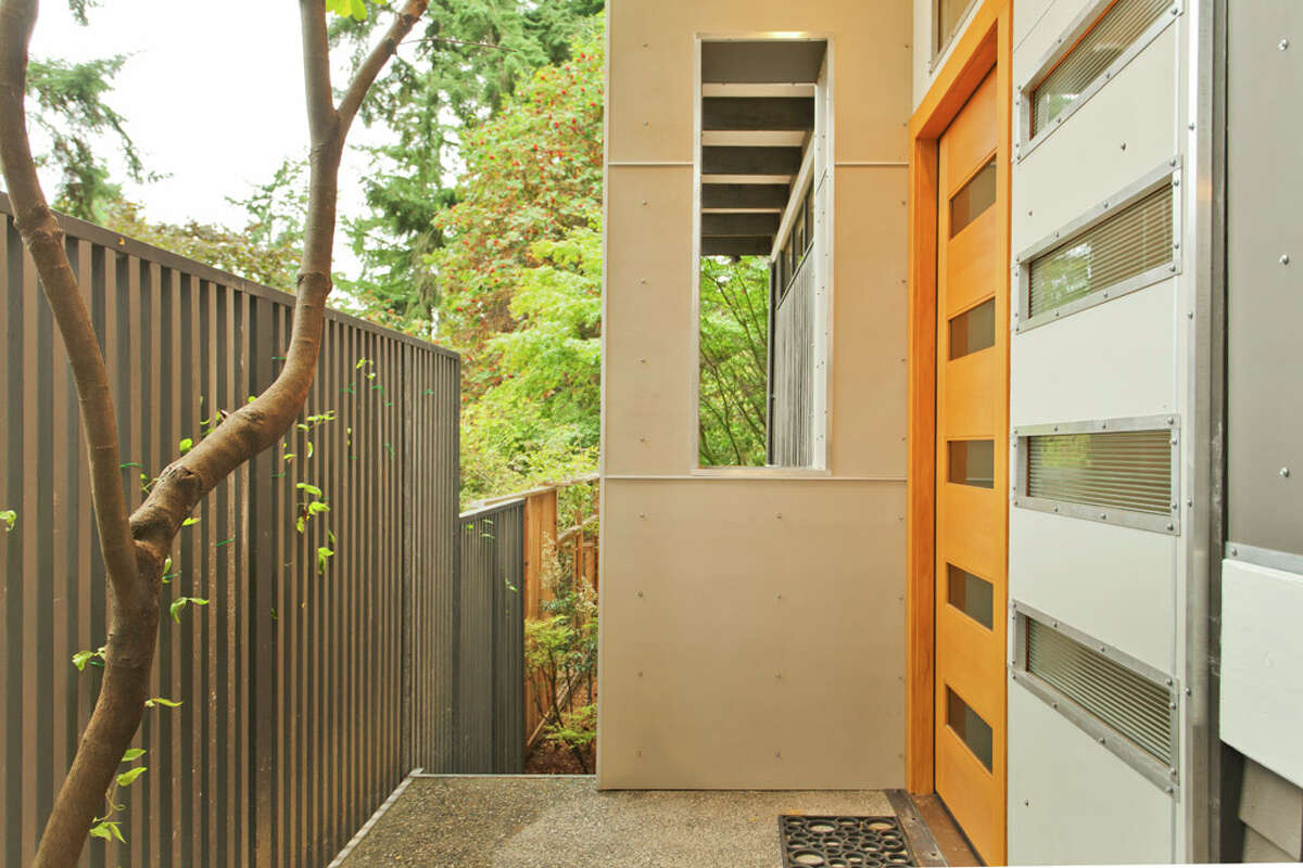 Entry of 13249 6th Ave. N.W.. The 3,850-square-foot house, built in 1965, has five bedrooms, 2.75 bathrooms, walls of windows, beamed ceilings, skylights, a large deck, a patio and a two-car garage on an 8,100-square-foot lot. It's listed for $899,950.