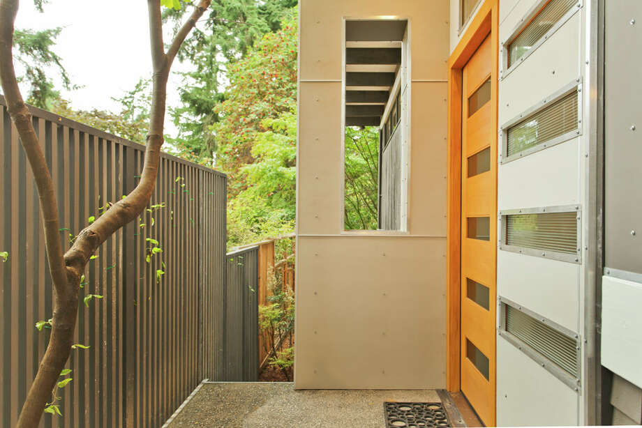 Entry of 13249 6th Ave. N.W.. The 3,850-square-foot house, built in 1965, has five bedrooms, 2.75 bathrooms, walls of windows, beamed ceilings, skylights, a large deck, a patio and a two-car garage on an 8,100-square-foot lot. It's listed for $899,950. Photo: COurtesy Tim Lenihan/Windermere Real Estate / (c) 2012 Malia Campbell Photography