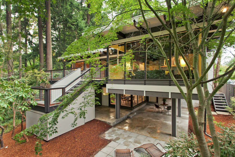 Here's a cool modern home in Broadview, built in 1965 and recently updated. The house, 13249 6th Ave. N.W., is 3,850 square feet, with has five bedrooms, 2.75 bathrooms, walls of windows, beamed ceilings, skylights, a large deck, a patio and a two-car garage on an 8,100-square-foot lot. It's listed for $899,950. Photo: COurtesy Tim Lenihan/Windermere Real Estate / (c) 2012 Malia Campbell Photography
