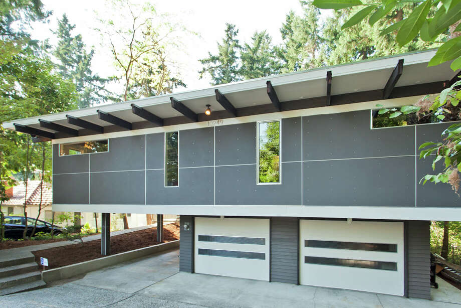 Exterior of 13249 6th Ave. N.W.. The 3,850-square-foot house, built in 1965, has five bedrooms, 2.75 bathrooms, walls of windows, beamed ceilings, skylights, a large deck, a patio and a two-car garage on an 8,100-square-foot lot. It's listed for $899,950. Photo: COurtesy Tim Lenihan/Windermere Real Estate / (c) 2012 Malia Campbell Photography