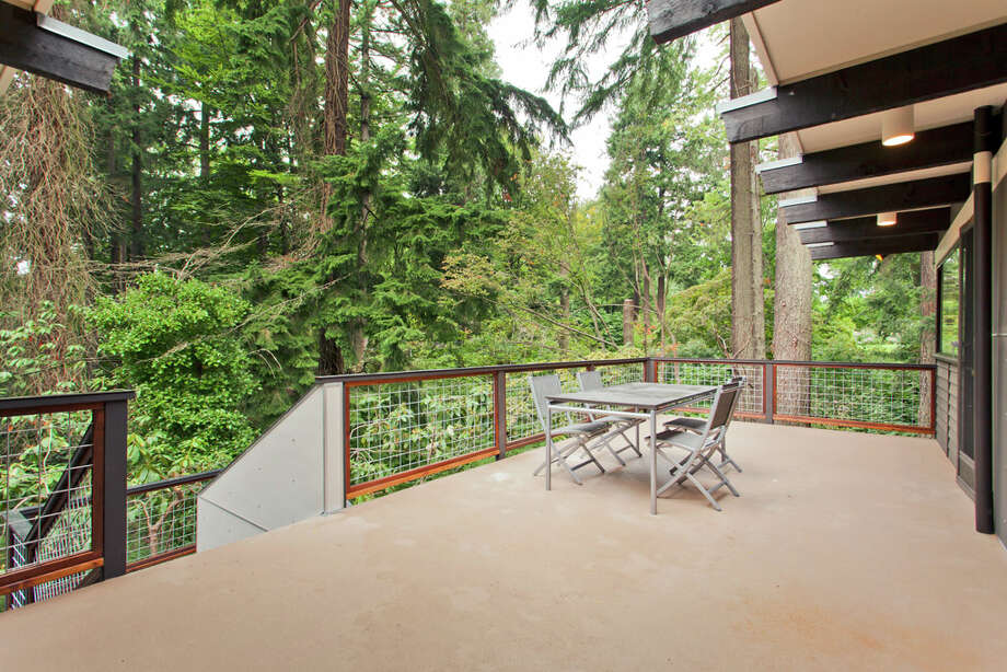 Deck of 13249 6th Ave. N.W.. The 3,850-square-foot house, built in 1965, has five bedrooms, 2.75 bathrooms, walls of windows, beamed ceilings, skylights, a patio and a two-car garage on an 8,100-square-foot lot. It's listed for $899,950. Photo: COurtesy Tim Lenihan/Windermere Real Estate / (c) 2012 Malia Campbell Photography