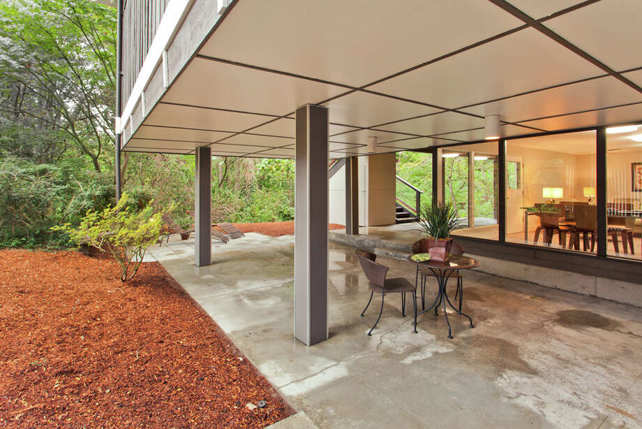 Patio of 13249 6th Ave. N.W.. The 3,850-square-foot house, built in 1965, has five bedrooms, 2.75 bathrooms, walls of windows, beamed ceilings, skylights, a large deck and a two-car garage on an 8,100-square-foot lot. It's listed for $899,950. Photo: COurtesy Tim Lenihan/Windermere Real Estate / (c) 2012 Malia Campbell Photography