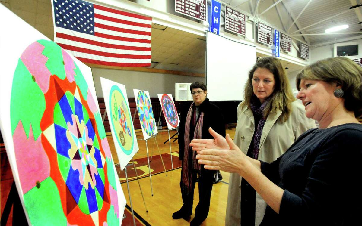 Wendy Northup, right, the art teacher who created the Sand Mandala project at Wooster School in Danbury, talks to Deirdre Klepacz about the art after viewing the Dali Lama's live streaming telecast on Friday, Oct. 19, 2012.