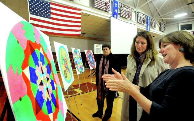 Wendy Northup, right, the art teacher who created the Sand Mandala project at Wooster School in Danbury, talks to Deirdre Klepacz about the art after viewing the Dali Lama's live streaming telecast on Friday, Oct. 19, 2012. Photo: Michael Duffy / The News-Times