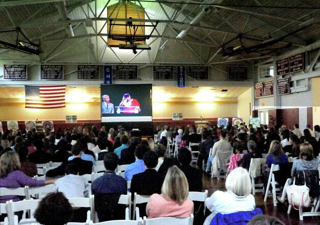 Students and faculity at Wooster School in Danbury view the Dali Lama's live streaming telecast on Friday, Oct. 19, 2012. Photo: Michael Duffy