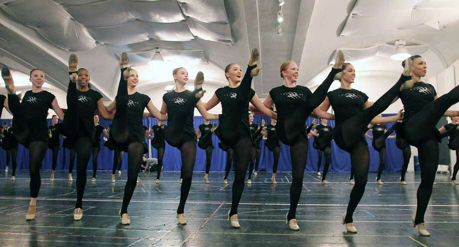 This image released by Starpix shows Rockettes dancers rehearsing for the Radio City Christmas Spectacular at the St. Paul the Apostle Church, Thursday, Oct. 18, 2012, in New York. The Radio City Christmas Spectacular will celebrate its 85th anniversary of the Rockettes this year. The show opens Nov. 9 through Dec. 30. Photo: Dave Allocca, AP / STARPIX