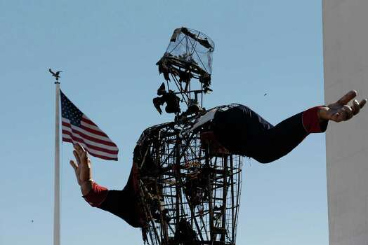 The burned remains of Big Tex stand at the State Fair of Texas Friday, Oct. 19, 2012, in Dallas. Fire destroyed Big Tex on Friday, leaving behind little more than the metal frame of the 52-foot-tall metal-and-fabric cowboy that is an icon of the State Fair of Texas. (AP Photo/LM Otero) Photo: LM Otero, Associated Press / AP
