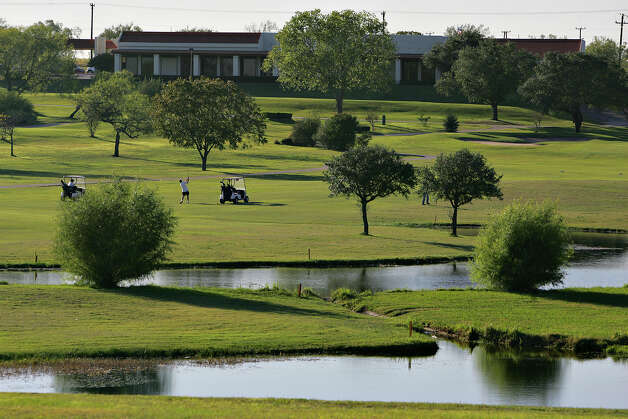 The clubhouse is seen beyond a water hazard and fairway Friday, November 17, 2006 at Woodlake Golf Course. BAHRAM MARK SOBHANI/STAFF Photo: BAHRAM MARK SOBHANI, EXPRESS-NEWS FILE PHOTO / SAN ANTONIO EXPRESS NEWS