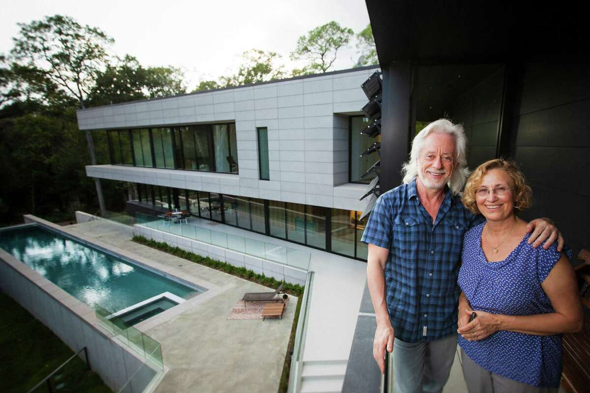 Michael and Natasha Bleyzer pose for a portrait outside their 15,000-square-foot house overlooking a wooded nature preserve on the banks of Buffalo Bayou and designed by the firm Stern & Bucek, Wednesday, Oct. 10, 2012, in Houston. The Bleyzer House is on this year's American Institute of Architects Home Tour 2012. ( Michael Paulsen / Houston Chronicle )