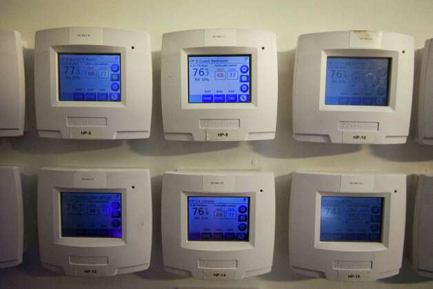 Thermostats inside Michael Bleyzer's control center that operates his network based 15,000-square-foot house overlooking a wooded nature preserve on the banks of Buffalo Bayou and designed by the firm Stern & Bucek, Wednesday, Oct. 10, 2012, in Houston.  The Bleyzer House is on this year's American Institute of Architects Home Tour 2012.  ( Michael Paulsen / Houston Chronicle ) Photo: Michael Paulsen / © 2012 Houston Chronicle