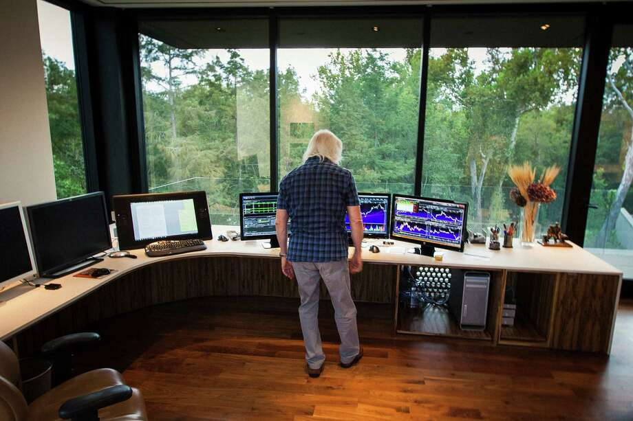 Michael Bleyzer's office overlooks a wooded nature preserve on the banks of Buffalo Bayou. Photo: Michael Paulsen / © 2012 Houston Chronicle
