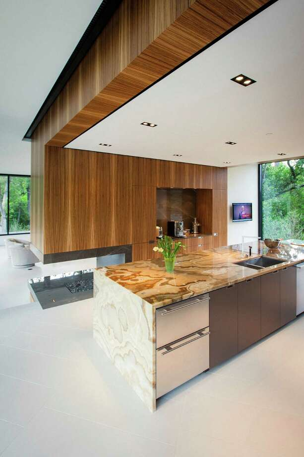 The kitchen inside the Bleyzer home keeps with the couple's love of modern design. Photo: Michael Paulsen / © 2012 Houston Chronicle
