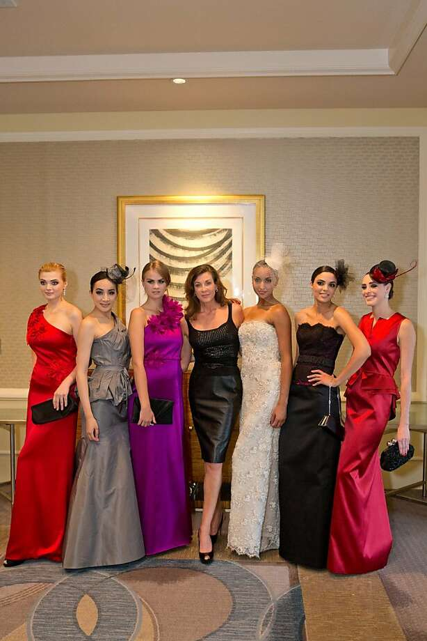 Scottish-born fashion designer Julia Panciroli, center, strikes a pose alongside models wearing looks from her latest collection at the Bay Area Arthritis Auxiliary's 10th annual benefit and fashion show. Hundreds of supporters attended the event at the San Francisco Four Seasons Hotel, which included a silent auction but plenty of thunderous applause for the colorful gowns and the heartfelt presentation by 13-year-old honoree Katie Harrison-Wallach. Photo: Drew Altizer Photography, Drew Altizer