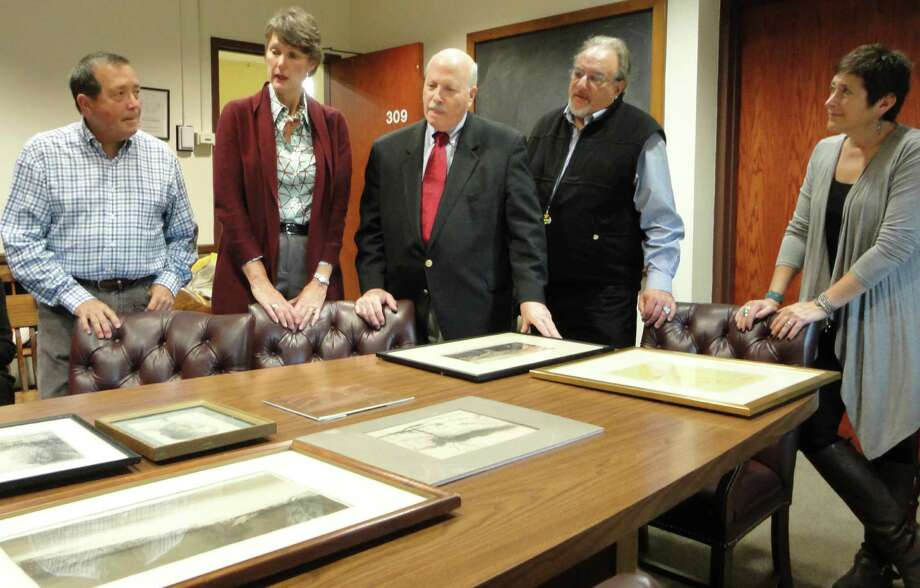 First Selectman Gordon Joseloff, center, admires some of the 21 paintings donated Friday to the Westport Schools Permanent Arts Collection by Rebecca A. Merrilees, daughter of acclaimed painter and WPA artist Ralph L. Boyer (1879-1952). Also pictured, from left, are: Ron Slater of Westport, Merrilees' nephew; Kathie Bennewitz, co-chairwoman of the Westport Schools Permanent Art Collection; Mark Waskow of Barre, Vt., an independent curator, and Carole Erger-Fass, the other collection co-chairwoman. Photo: Meg Barone / Westport News freelance