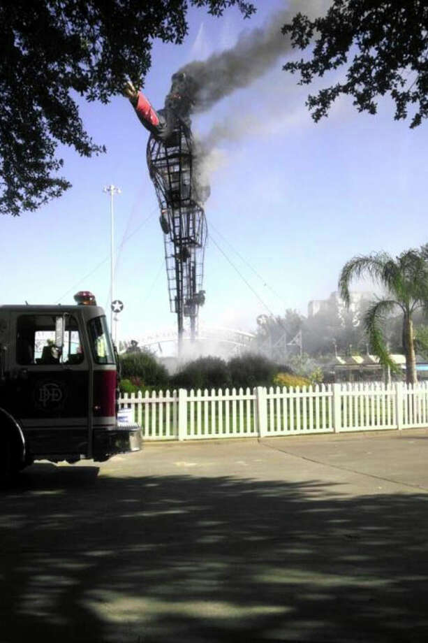 Big Tex smolders later Friday morning. Photo: Paolo Tang