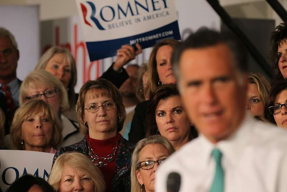 HARTFORD, CT - APRIL 11:  Women watch as Republican presidential candidate and former Massachusetts Governor Mitt Romney speaks to supporters on April 11, 2012 in Hartford, Connecticut. Romney spoke at Alpha Graphics in Hartford and will later attend a small business town hall meeting in Warwick, Rhode Island. With Rick Santorum, Romney's chief rival for the Republican nomination, out of the race, the former Massachusetts governor is now the presumptive Republican nominee.  (Photo by Spencer Platt/Getty Images) Photo: Spencer Platt, Getty Images