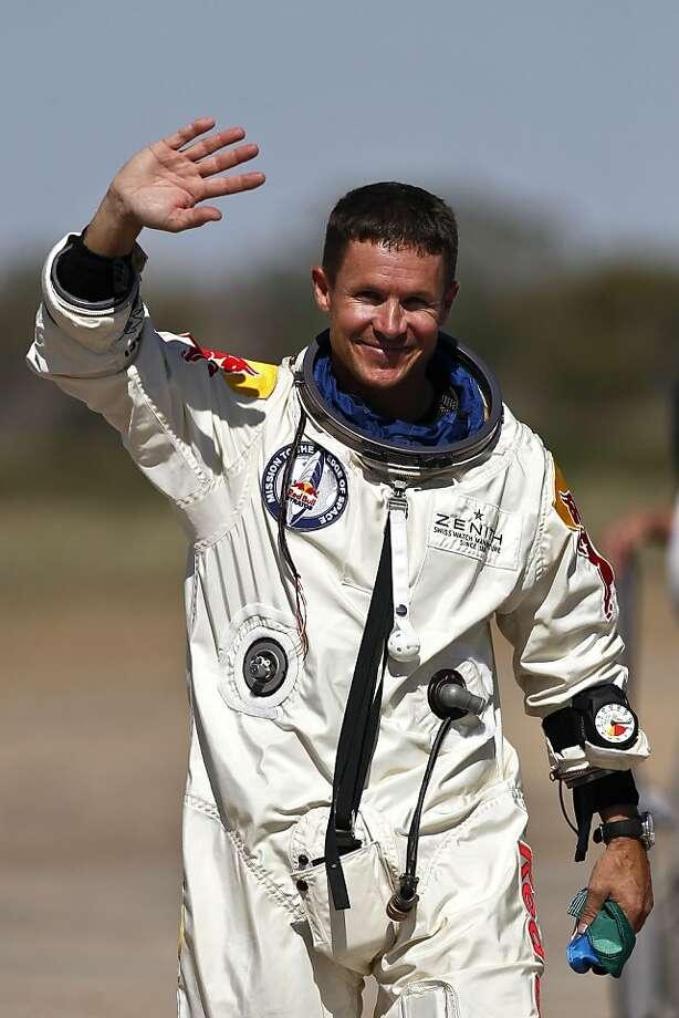 Skydiver Felix Baumgartner celebrates his record-setting leap. Photo: Ross Franklin, Associated Press
