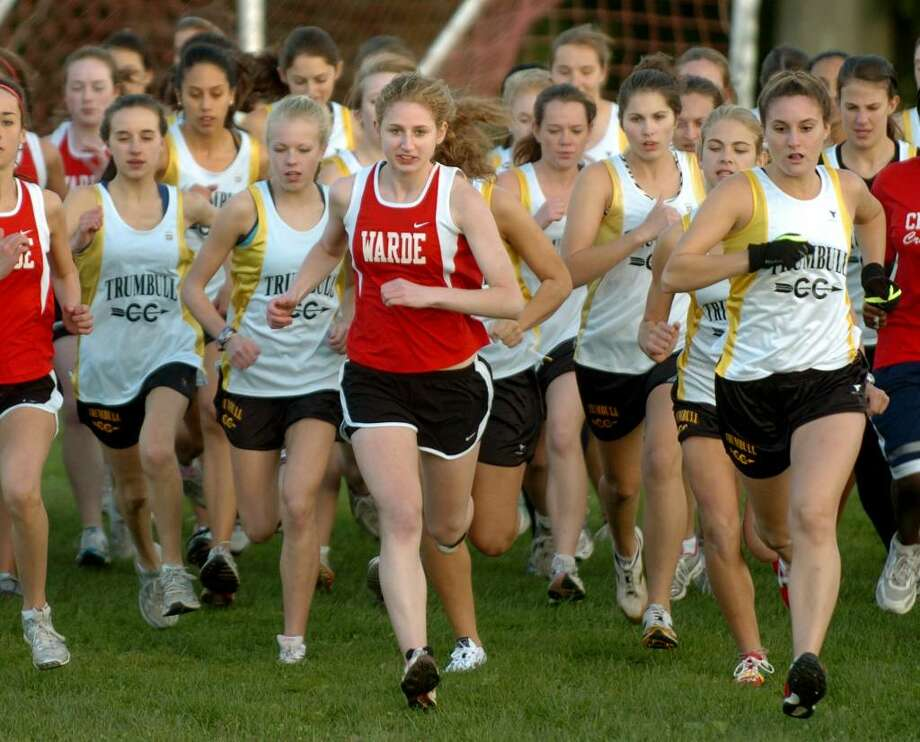 Fairfield Warde's Meg Ryan, center, leads the pack at the start of the girls cross country event at Trumbull High in Trumbull, Conn. on Tuesday Oct. 13, 2009. Photo: Christian Abraham / Connecticut Post