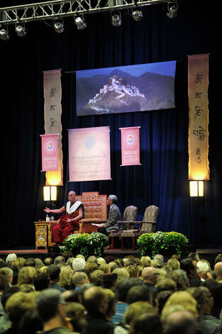 A scene of Tibet hangs above the Dalai Lama in the O'Neill Center on Western Connecticut State University's westside campus in Danbury on Friday, Oct. 19, 2012. Photo: Jason Rearick / The News-Times