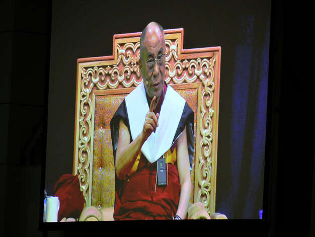 "The Dalai Lama, as projected onto a video screen, answers questions after giving his ""Advice for Daily Life"" speech in the O'Neill Center on Western Connecticut State University's westside campus in Danbury on Friday, Oct. 19, 2012. Photo: Jason Rearick / The News-Times"