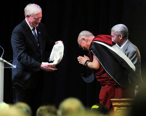 "President James Schmotter presents a khata, orTibetan offering scarf, to the Dalai Lama after the Dalai Lama answered questions and gave his ""Advice for Daily Life"" speech in the O'Neill Center on Western Connecticut State University's westside campus in Danbury on Friday, Oct. 19, 2012. Photo: Jason Rearick / The News-Times"