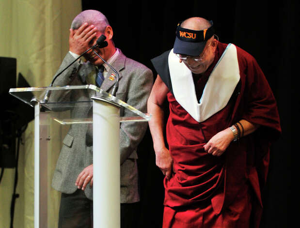 "The Dalai Lama and his translator, Thupten Jinpa, share a light moment on stage as the Dalai Lama gives his ""Advice for Daily Life"" speech in the O'Neill Center at Western Connecticut State University's westside campus in Danbury on Friday, Oct. 19, 2012. Photo: Jason Rearick / The News-Times"