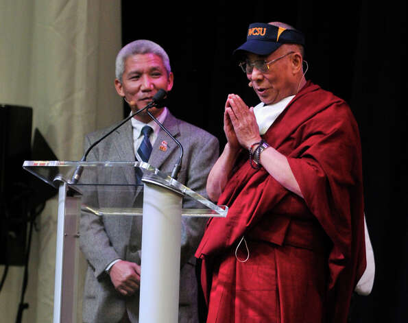 "Translator Thupten Jinpa, left, stands by to help the Dalai Lama during his ""Advice for Daily Life"" speech in the O'Neill Center on Western Connecticut State University's westside campus in Danbury on Friday, Oct. 19, 2012. Photo: Jason Rearick / The News-Times"