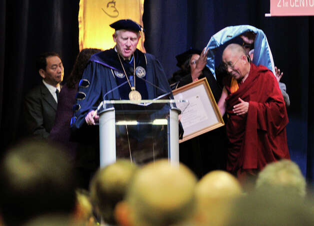 The Dalai Lama, right, is awarded an honorary doctorate of humane letters on stage before speaking in the O'Neill Center on Western Connecticut State University's westside campus in Danbury on Friday, Oct. 19, 2012. Photo: Jason Rearick / The News-Times