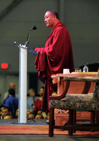 Geshe Lobsang Dhargye, resident teacher and scholar at Do Ngak Kunphen Ling Tibetan Buddhist Center in Redding, speaks to a crowd before the Dalai Lama speaks in the O'Neill Center at Western Connecticut State University's westside campus in Danbury on Friday, Oct. 19, 2012. Photo: Jason Rearick / The News-Times