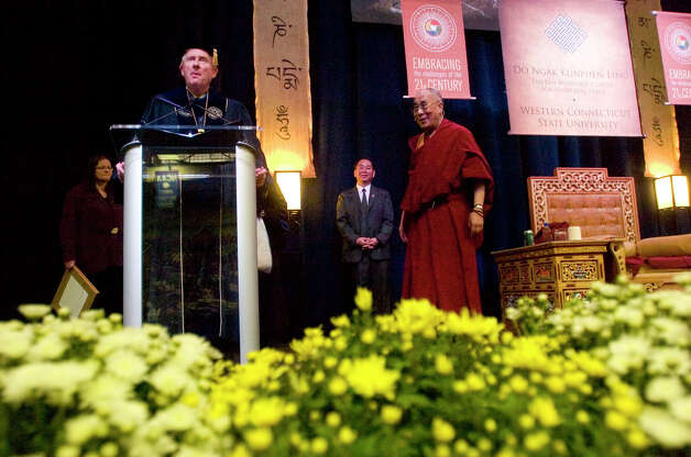 WestConn president James Schmotter, left, greets the Dalai Lama on stage at the O'Neill Center on Western Connecticut State University's westside campus in Danbury on Friday, Oct. 19, 2012. Photo: Jason Rearick / The News-Times