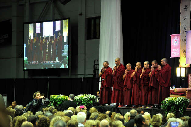 Buddhist monks chant before the Dalai Lama speaks in the O'Neill Center on Western Connecticut State University's westside campus in Danbury on Friday, Oct. 19, 2012. Photo: Jason Rearick / The News-Times