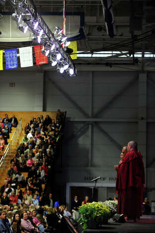 Buddhist monks chant before the Dalai Lama's appearance in the O'Neill Center on Western Connecticut State University's westside campus in Danbury on Friday, Oct. 19, 2012. Photo: Jason Rearick / The News-Times