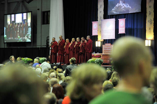 People take their seats as Buddhist monks chant before the Dalai Lama speaks in the O'Neill Center on Western Connecticut State University's westside campus in Danbury on Friday, Oct. 19, 2012. Photo: Jason Rearick / The News-Times