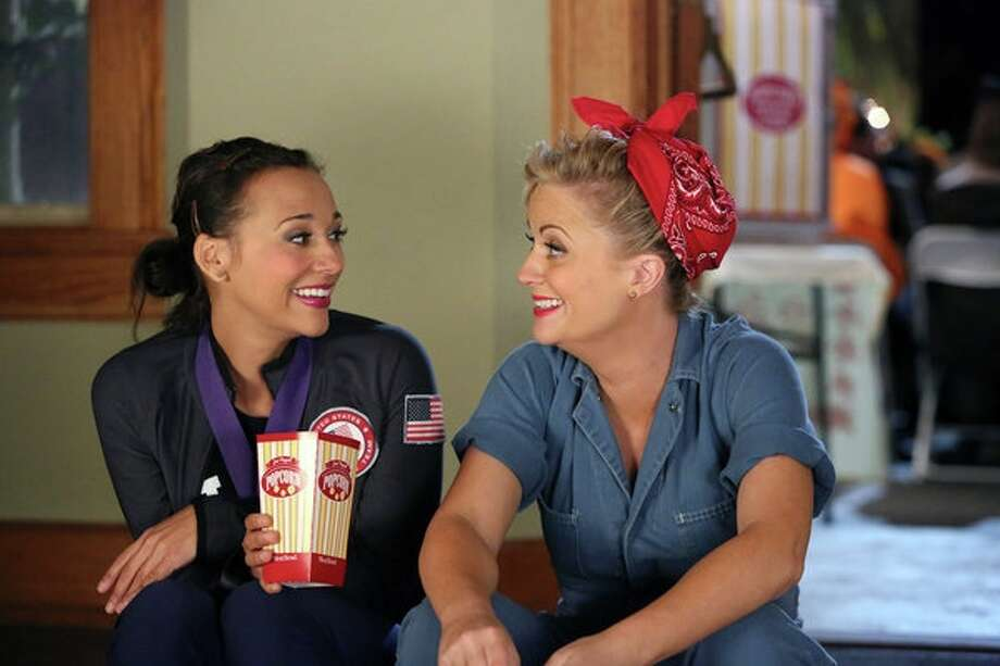 Ann (Rashida Jones) dresses up as an Olympic medalist and newly elected Pawnee Councilwoman Leslie Knope (Amy Poehler) comes as Rosie the Riveter for a hilarious Halloween episode of 'Parks and Recreation'. Photo: NBC