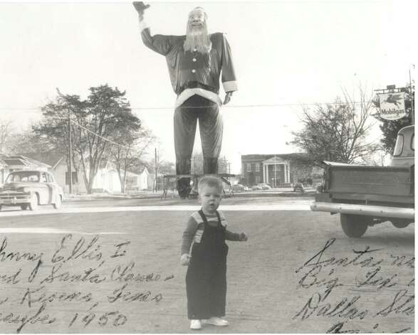 The frame work that became Big Tex is seen in a 1950 photo provided Oct. 19, 2012, by the State Fair of Texas, when the frame was dressed as Santa Claus in the northeast Texas town of Kerens. Photo: Courtesy Photo, State Fair Of Texas / COURTESY OF THE STATE FAIR OF TEXAS