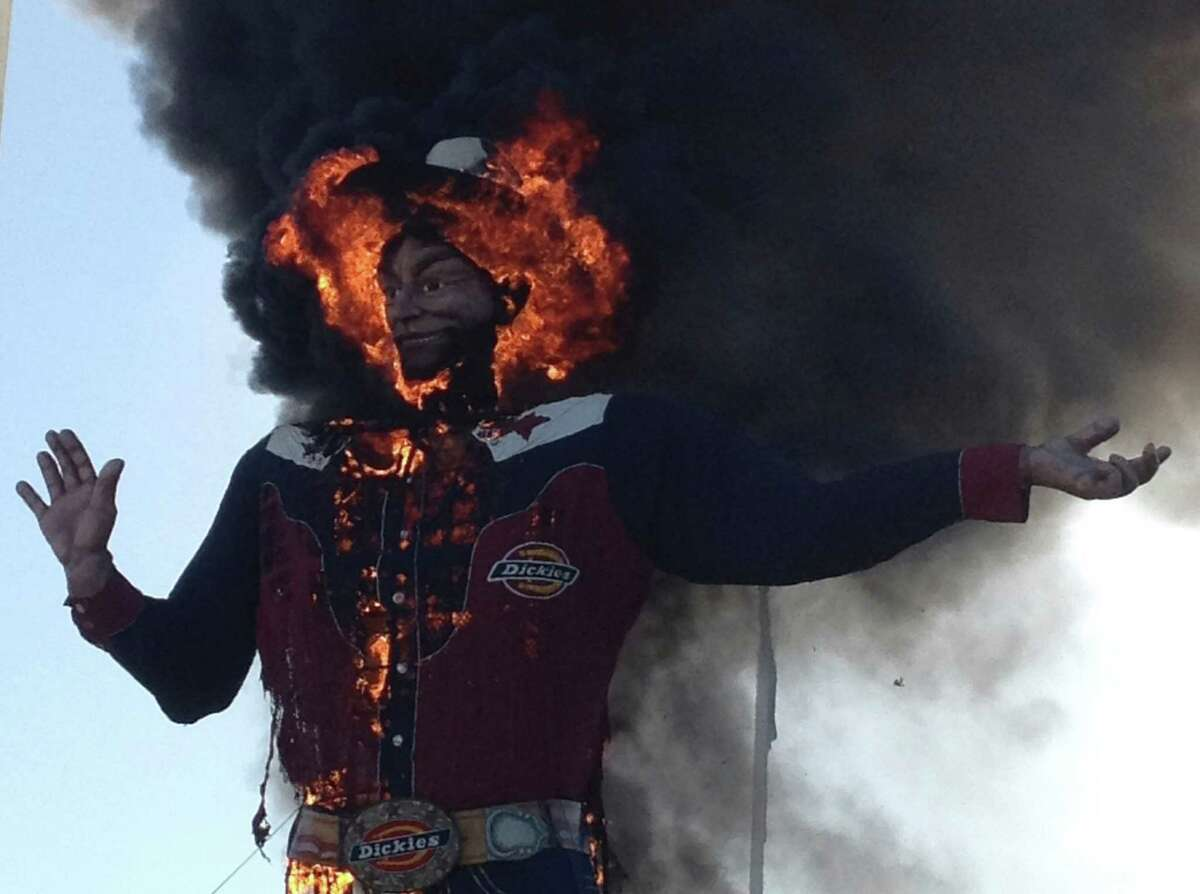 Fire engulfs the Big Tex cowboy statue displayed at the State Fair of Texas in Dallas on Friday, Oct. 19, 2012. The iconic structure caught fire and burned this morning.