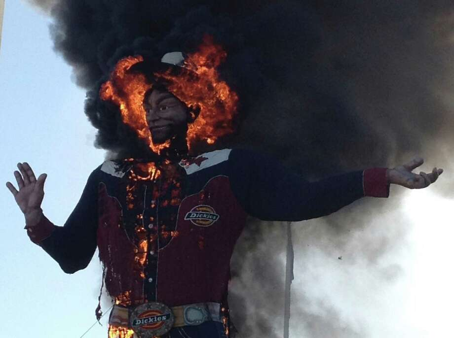 Fire engulfs Big Tex at the State Fair of Texas. Officials said the statue will be repaired in time for the 2013 exposition. Photo: John McKibben, Associated Press / John McKibben