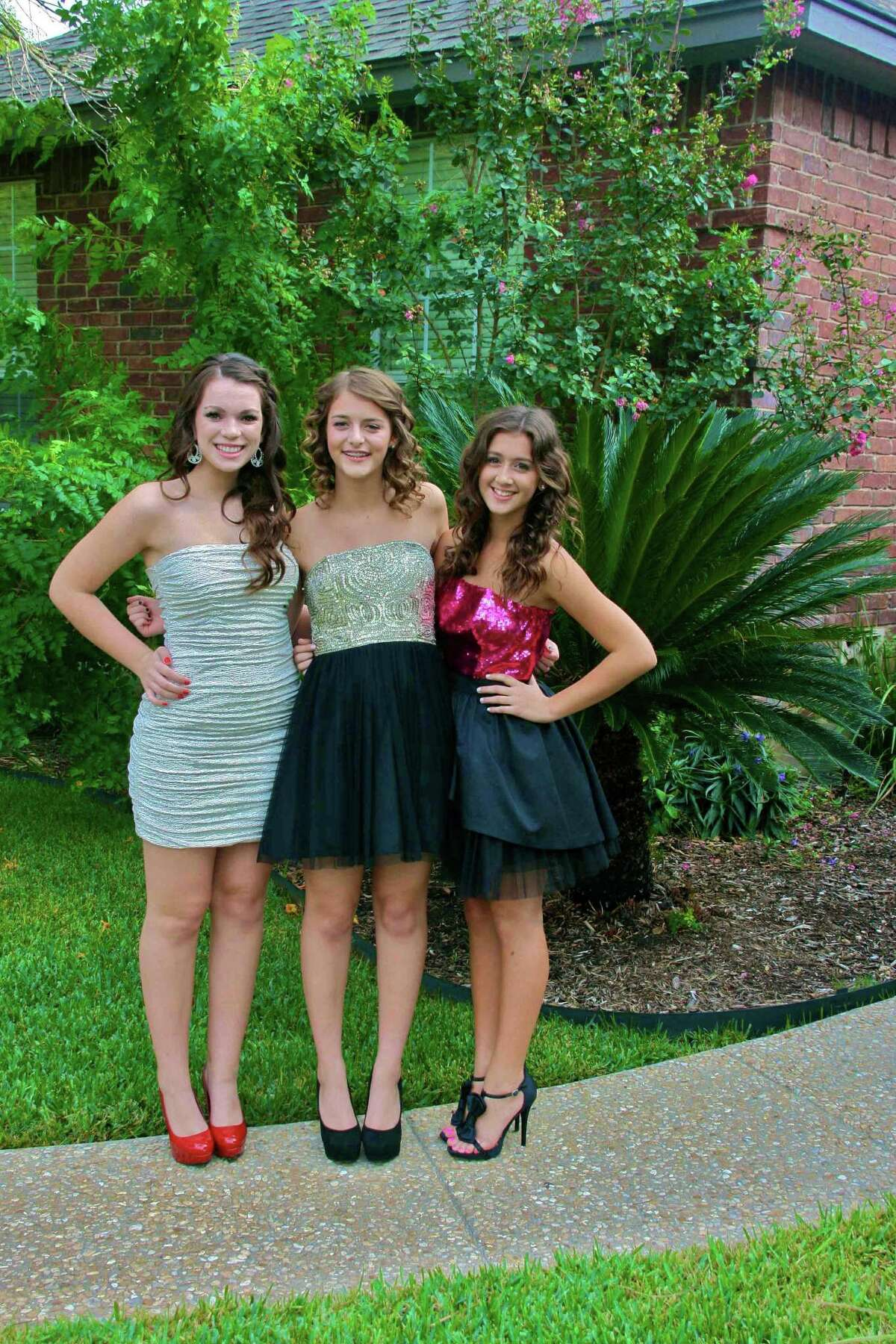 Churchill High School sophomores (from left) Sydney Sanders, Jordan Howard and Kaylee Booth were ready to enjoy the campus homecoming dance Sept. 29 at Blossom Athletic Center when an anonymous bomb threat halted that and a nearby Johnson/MacArthur football game. Churchill community members have raised funds for a replacement dance in November.