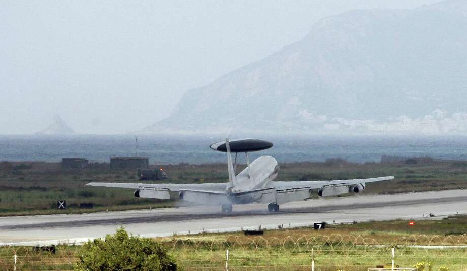 A NATO E-3 AWACS aircraft lands at the Trapani Birgi air base on the Italian island of Sicily on March 19, 2011. Photo: MARCELLO PATERNOSTRO, AFP/Getty Images / 2011 AFP