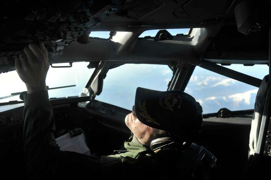 A pilot flies a French E-3 during an air surveillance mission above the Mediterranean sea on March 23,  2011,  after coalition forces launched air strikes in Libya. Photo: ALAIN JOCARD, AFP/Getty Images / 2011 AFP