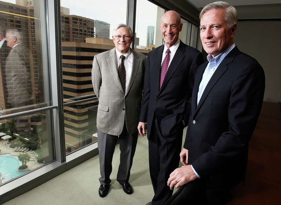 Crain, Caton & James partners David Griffis, left, current president Rob Wisner and Larry George are celebrating their firm's 100th year. It has 36 lawyers and 35 support staff, occupying the middle ground on size. Photo: Nick De La Torre / © 2012  Houston Chronicle