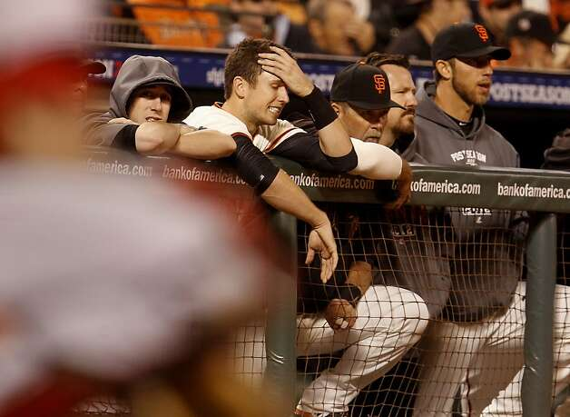 Buster Posey and other Giants reacted to events during their last at bat, Posey would later strike out to end the game. The San Francisco Giants and the Cincinnati Reds in game one of the National League Division Series Saturday October 6, 2012 at AT&T park. Photo: Brant Ward, The Chronicle