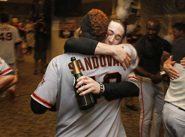 Pablo Sandoval and Tim Lincecum embrace in the winning clubhouse in Cincinnati. Sandoval had two hits and scored a run in the clincher. Lincecum got the win in Game 4, pitching nearly half the game in relief. Photo: Michael Macor, The Chronicle