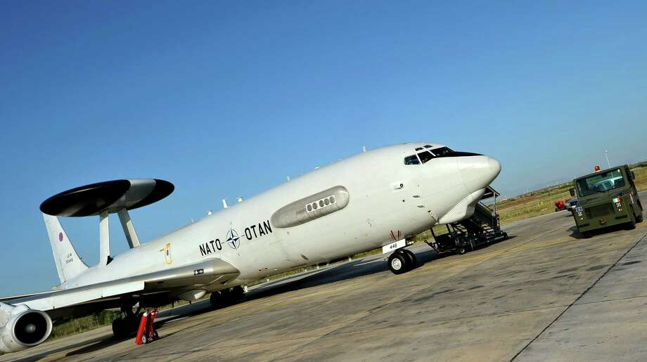 A NATO E-3 AWACS aircraft is readied at the Trapani-Birgi base in Italy on July 9, 2011 before flying over the Mediterranean sea during the NATO Unified Protector operation over Libya. Photo: ALBERTO PIZZOLI, AFP/Getty Images / 2011 AFP